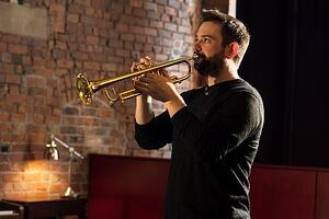 Gary Farr plays the trumpet